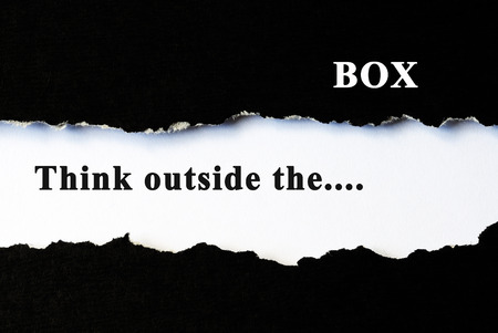 receptive: Think outside the box concept phrase under torn paper