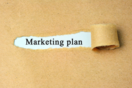 brand damage: Torn paper with marketing plan text.