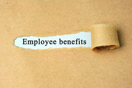 Ripped paper with  Employee benefits text. Stock fotó