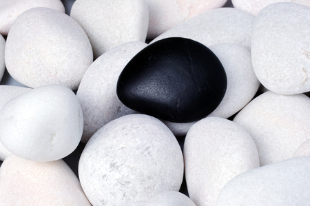 Being different, stand out of a crowd conceptual, zen stones with words be yourself.