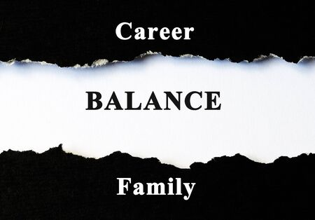 health equity: Career, balance and family concept word under torn paper
