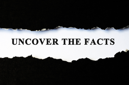 deceit: Uncover the facts concept phrase under torn paper Stock Photo