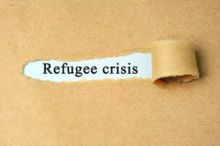 brand damage: Ripped paper with  refugee crisis text.