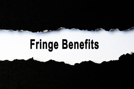 Fringe benefits words under torn paper