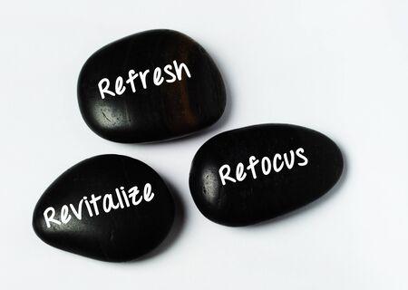 revitalize: Three black zen stones, spa beauty and wellness concept