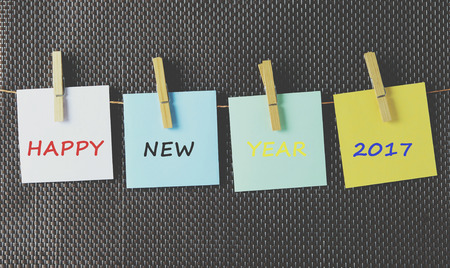 paper pin: Happy new year 2017 on colorful paper attached on a string with clothes pin Stock Photo