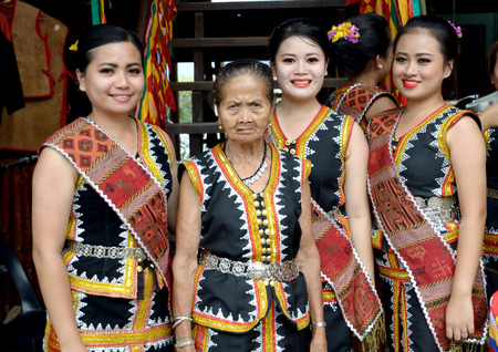 kinabalu: KOTA KINABALU, MALAYSIA - MAY 31, 2016: Young and elderly Malaysian woman in traditional costumes during Sabah Harvest festival celebration in Kota Kinabalu, Sabah Borneo, Malaysia.