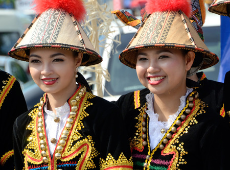 kinabalu: KOTA KINABALU, MALAYSIA - MAY 31, 2016: Malaysian women from ethnic Kadazan in traditional costume during Sabah Harvest festival celebration in Kota Kinabalu, Sabah Borneo, Malaysia.