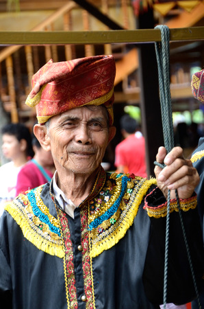 ethnic attire: KOTA KINABALU, MALAYSIA - MAY 31, 2016:  Man in traditional costumes during Sabah Harvest festival celebration in Kota Kinabalu, Sabah Borneo, Malaysia. Editorial