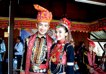 KOTA KINABALU, MALAYSIA - MAY 31, 2016:  Young man and woman in Dusun Lotud traditional costumes during Sabah Harvest festival celebration in Kota Kinabalu, Sabah Borneo, Malaysia. Editorial