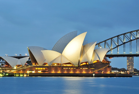 SYDNEY, AUSTRALIA - OCTOBER 18, 2015: The Sydney Opera House and the iconic bridge viewed from Mrs Macquarie's point in Sydney. The Sydney Opera house and the bridge are iconic landmark in Australia.