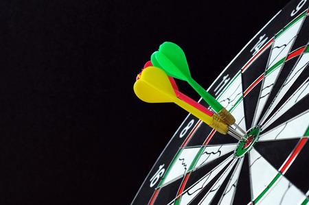 Three darts hits on dartboard target Stock Photo