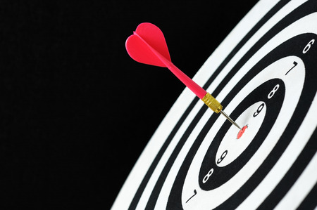 Red dart on dartboard target. Stock Photo
