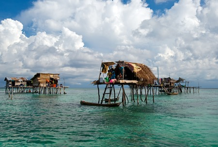 Semporna, Malaysia - 19 April, 2015: A Bajau floating village of stilted houses off the coast of Borneo in The Celebes Sea in the vicinity of Sipidan and Tun Sakaran Marine Park. Editorial