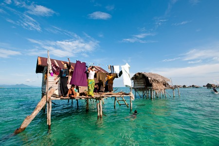 Semporna, Malaysia - 17 September, 2011: Bajau laut in their floating village of stilted houses off the coast of Borneo in The Celebes Sea in the vicinity of Sipidan and Tun Sakaran Marine Park. Editorial