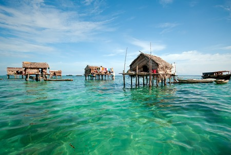 Bajau laut floating village of stilted houses off the coast of Borneo in The Celebes Sea in the vicinity of Sipidan and Tun Sakaran Marine Park.