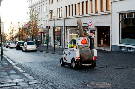 Reykjavik, Iceland - September 22, 2013: Waste vacuum cleaner truck on the street of Reykjavik.