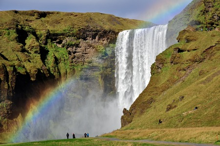 Skogafoss waterfall in Iceland. Skogafoss is a waterfall situated on the Skoga River in the south of Iceland at the cliffs of the former coastline.