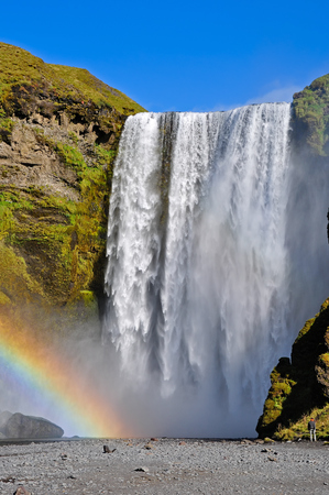 Skogafoss waterfall and rainbow. Skogafoss is a waterfall situated on the Skoga River in the south of Iceland at the cliffs of the former coastline.