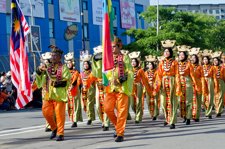 Kota Kinabalu, Malaysia - August 31, 2016: Malaysian from Sabah Borneo Bajau ethnic group in their traditional costumes participate in 59th Independence Day  in Kota Kinabalu City square.