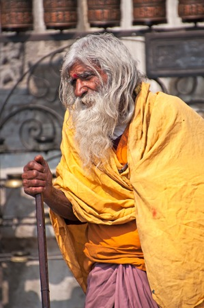 Kathmandu, Nepal - March 9, 2013: Sadhu in Swayambhunath Temple. A sadhu is a religious ascetic, mendicant or any holy person in Hinduism and Jainism who has renounced the worldly life.