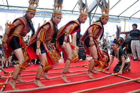 Kota Kinabalu , Malaysia - May 30, 2014: Kadazan Murut Magunatip dancers performance during Harvest Festival in Kota Kinabalu in Sabah. Editorial