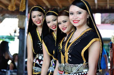Kota Kinabalu , Malaysia - May 30, 2014: Beautiful dancers of Kadazan Dusun ethnic from Ranau, an indigenous Sabah Borneo people during Harvest Festival in Kota Kinabalu, Sabah Borneo, Malaysia.