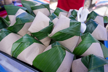 Nasi lemak wrapped with banana leaves and paper for sell in Kota Kinabalu, Sabah Borneo, Malaysia. Фото со стока