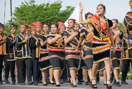 Kota Kinabalu, Malaysia - August 31, 2017: People from the Lotud ethic of Borneo march during 60th Independence Day celebration in Kota Kinabalu city, Sabah State. Editorial