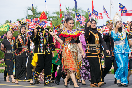 Kota Kinabalu, Malaysia - August 31, 2017: Multiracial Malaysian people with traditional attiremarch during 60th Independence Day celebration in Kota Kinabalu city, Sabah State.