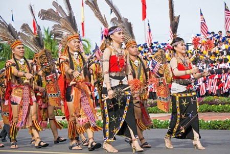 Kota Kinabalu, Malaysia - August 31, 2017: People from the Murut ethic of Borneo march during 60th Independence Day celebration in Kota Kinabalu city, Sabah State. Sajtókép