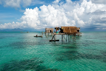 A Bajau laut floating village of stilted houses off the coast of Borneo in The Celebes Sea in the vicinity of Sipidan and Tun Sakaran Marine Park, Sabah Borneo, Malaysia.