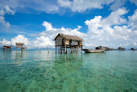Semporna, Malaysia - 19 April, 2015: A Bajau floating village of stilted houses off the coast of Borneo in The Celebes Sea in the vicinity of Sipidan and Tun Sakaran Marine Park. Stock Photo