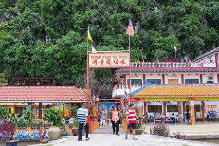 Ipoh, Malaysia - September 17, 2017: Buddha statues at Perak Kwan Yin Tong temple in Perak. Built beside a limestone hill, this ancient Buddhist temple honors goddess of mercy Kwan Yin Tong. Editorial