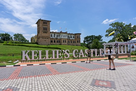 Ipoh, Malaysia - September 17, 2017: Tourist taking photo at Kellies Castle, popular attraction in Ipoh, Perak.