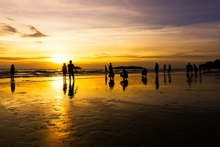 Silhouettes of beach goers at Tanjung Aru beach located in Kota Kinabalu, Sabah Borneo, Malaysia. Tanjung Aru is a famous beach among local and tourists.