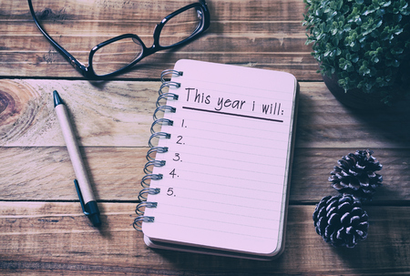 New year goals and resolution concept - This year i will on notepad. Retro style background. Banco de Imagens - 88549574