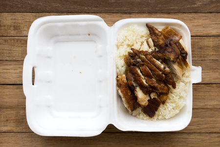 Chicken rice on a box, famous Asian dish. Stock Photo