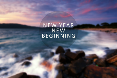 New Year inspirational quote - New Year New Beginning. Blurry background.
