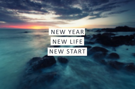New Year inspirational quote - New Year New Life New Start. Blurry background.