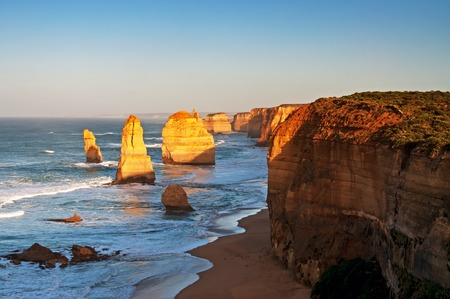 Sunrise over Twelves Apostles in Great Ocean Road, Victoria, Australia. The Twelve Apostles is a collection of limestone stacks off the shore of the Port Campbell National Park. Stock Photo