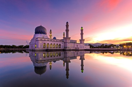 Beautiful sunrise over Kota Kinabalu city floating mosque. The mosque is one of the most popular landmark destination in Sabah Borneo, Malaysia. Stock Photo
