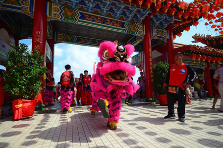 Kuala Lumpur, Malaysia - February 16, 2018: Lion dance during Chinese New Year celebration in Thean Hou Temple.