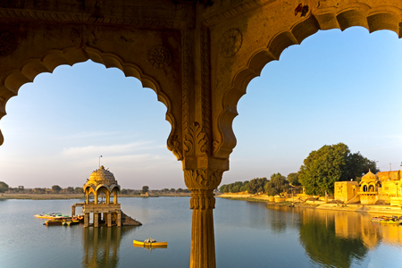 View of Gadi Sadar temple at Gadisar lake in Jaisalmer, Rajasthan, India.