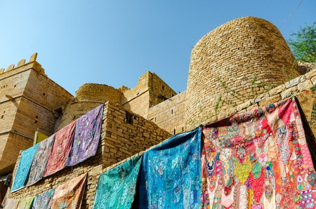 Wall draped with colorful textiles inside the Jaisalmer fort in Rajasthan, India. Stock Photo