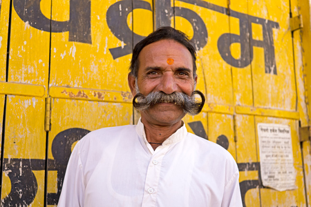 Mandawa, India - February 24, 2018: Portrait of a senior Indian man with fancy and cheeky mustache in Mandawa, Rajasthan. Stock Photo - 97816844