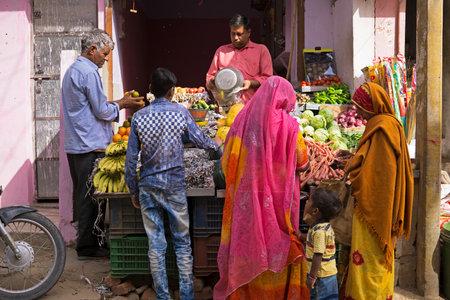 Mandawa, India - February 24, 2018: People buying fruit and vegetables at the street of Mandawa in Jhunjhunu district of Shekhawati region of Rajasthan.