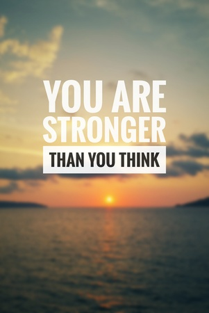 Inspirational quote - You are stronger than you think. Blurry sunset background. Stock Photo
