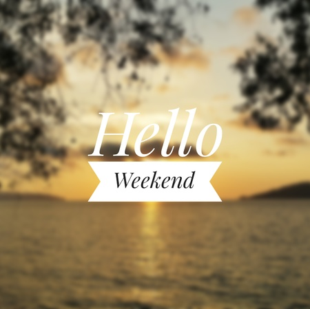 Hello Weekend greeting with blurry sunset background