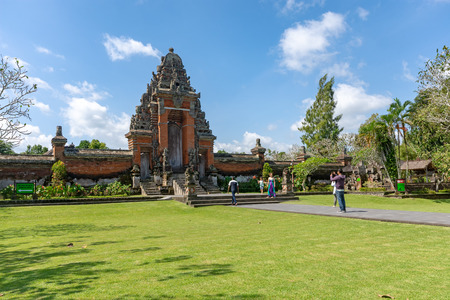 Badung, Indonesia - September 12, 2018: Tourist taking photo at the entrance of Taman Ayun temple, an ancient royal temple of Mengwi Empire.